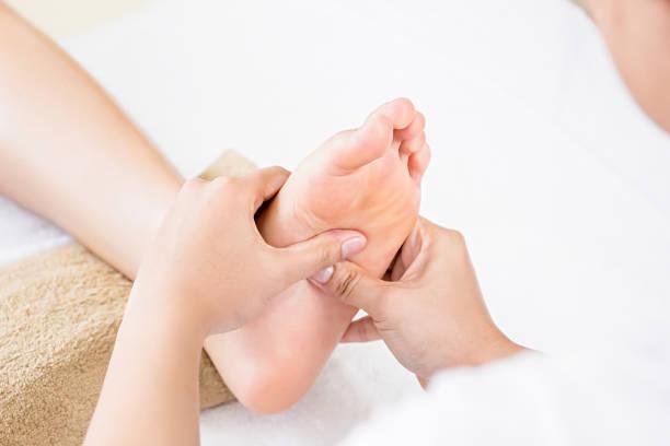 Relaxing traditional Thai foot reflexology massage stock photo