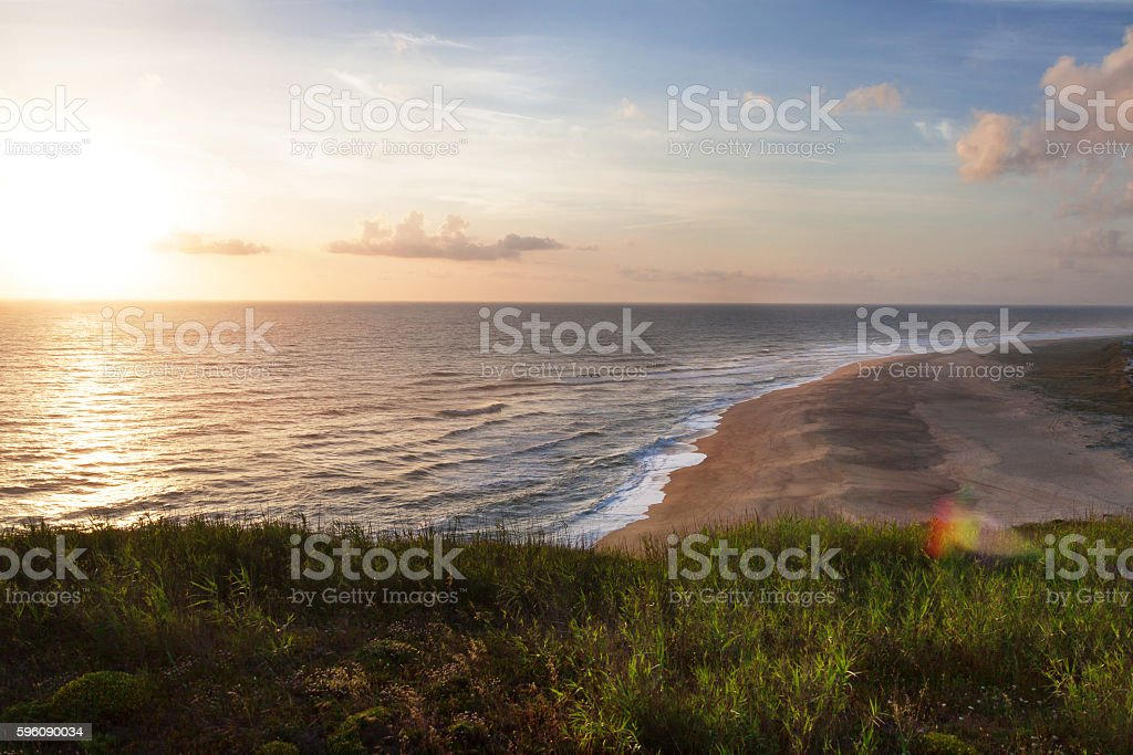 relaxing view of Nazare beach at sunset in Portugal Lizenzfreies stock-foto