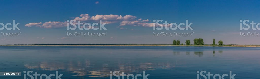 Relaxing water landscape with tree reflections stock photo