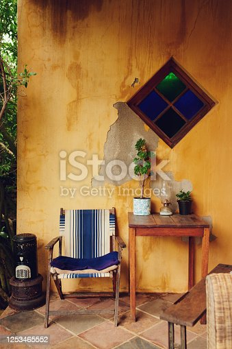 Shot of a chair, table and plants on the patio at home