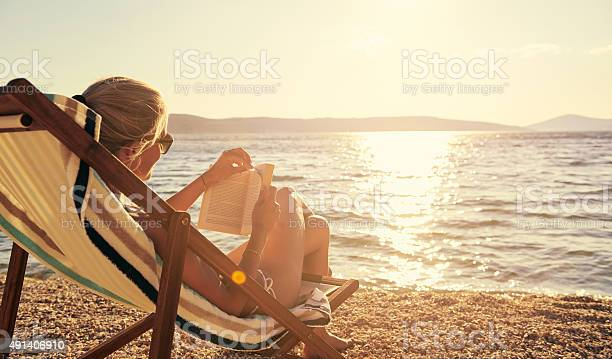 Relaxing with a good book in beautiful surroundings picture id491406910?b=1&k=6&m=491406910&s=612x612&h=pcnhpb qqm5mjpv6rt5iwhjuwiqw2ung kcl4lmoeke=