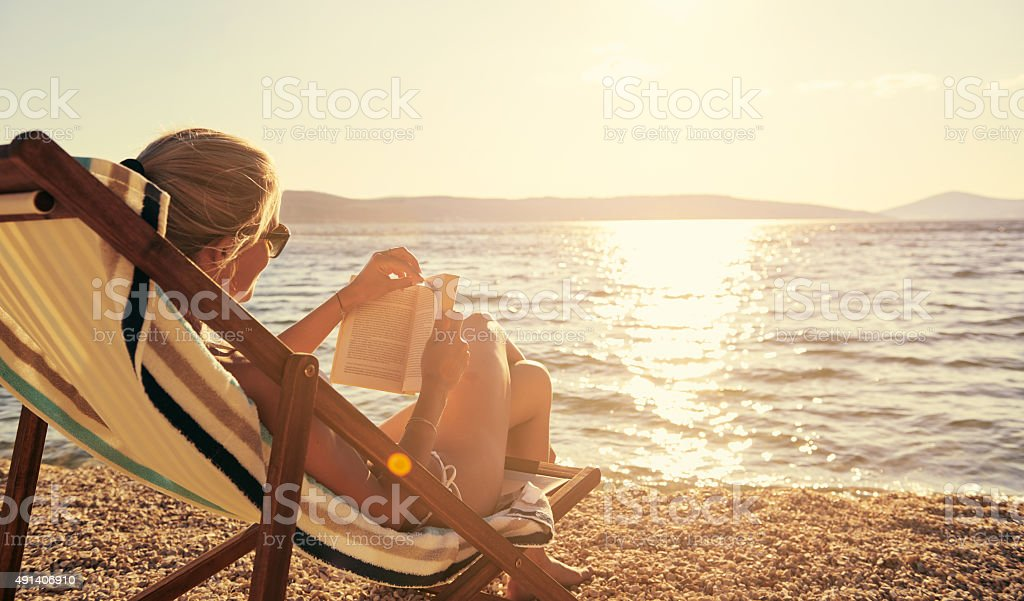 Relaxing with a good book in beautiful surroundings stock photo
