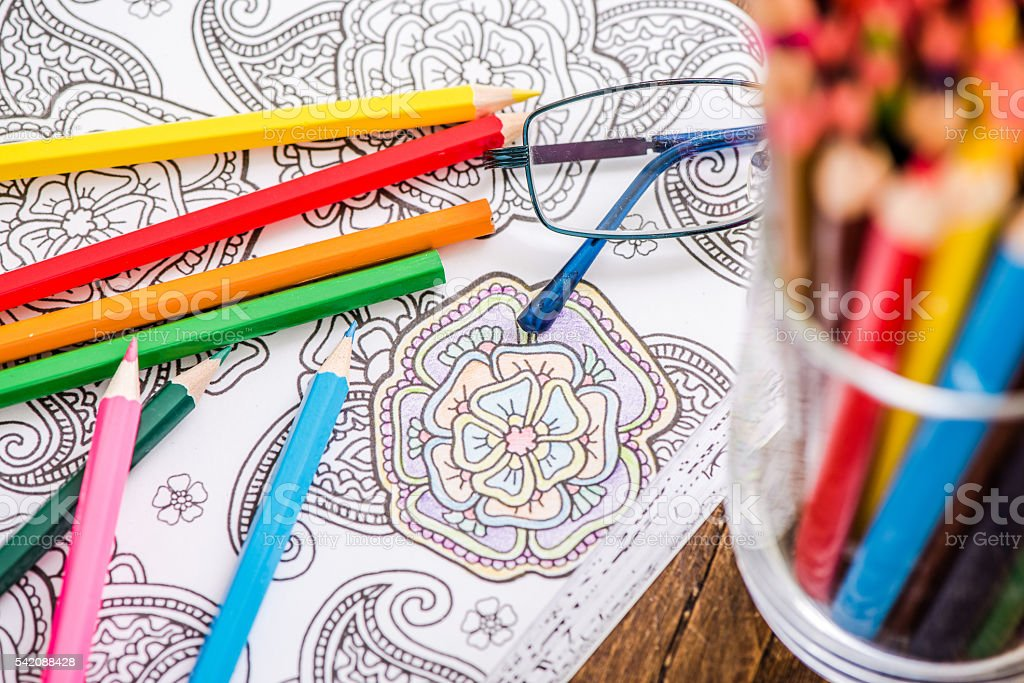 relaxing with adult coloring book stock photo