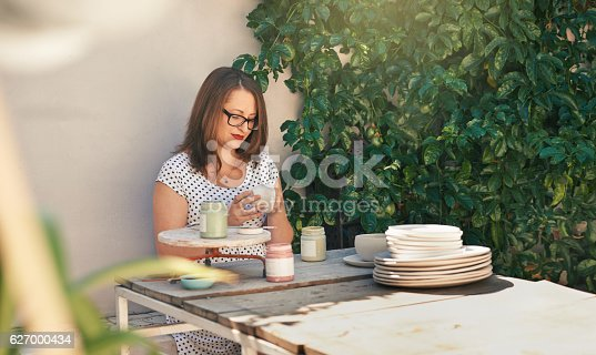 627000458istockphoto Relaxing with her favorite hobby 627000434