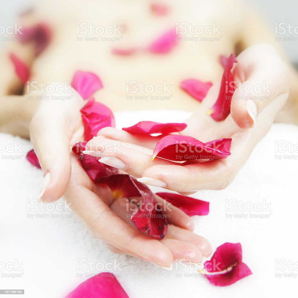 Relaxing with rose petals royalty-free stock photo