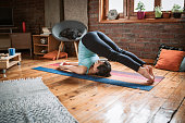istock Relaxing with yoga at home 1129448081