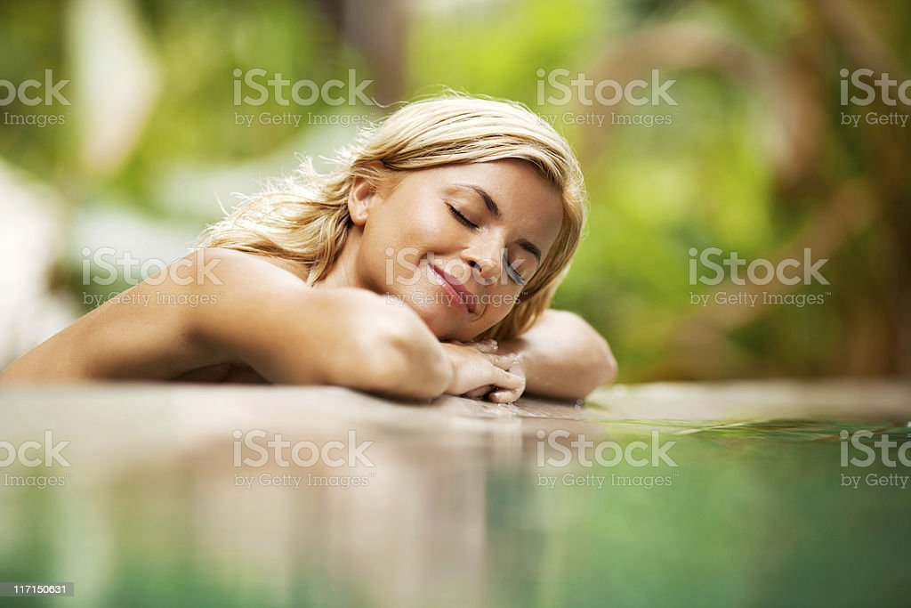 Relaxing woman near the water at nature. royalty-free stock photo