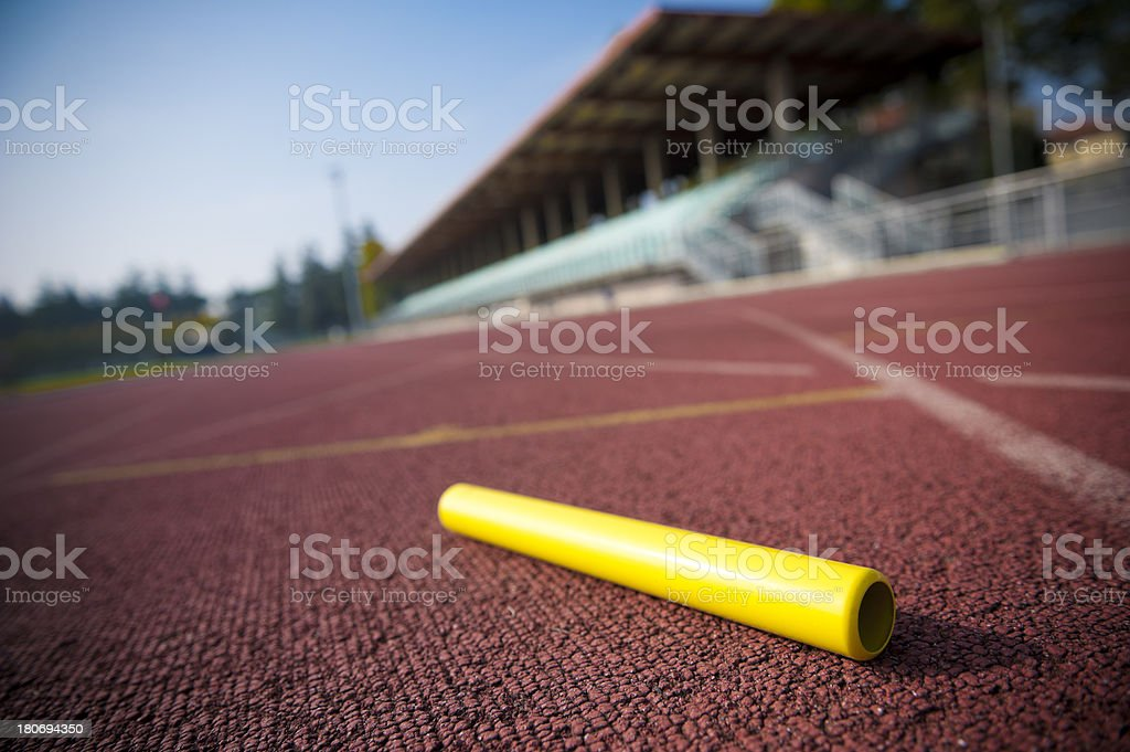 Relay baton on an athletics field stock photo