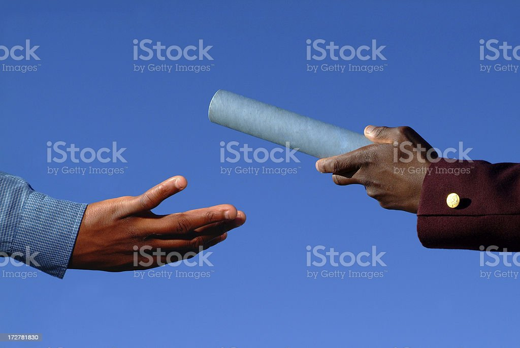 Relay baton passed by from one hand to another stock photo