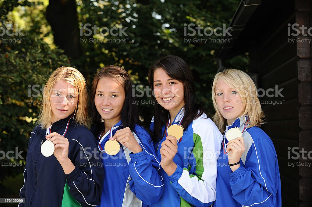 Relay team showing their medals royalty-free stock photo