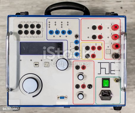 istock Relay test set equipment. Relay and protection testing 942519882