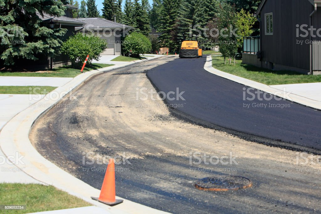 Re-Laying And Re-Surfacing The Residential Road stock photo