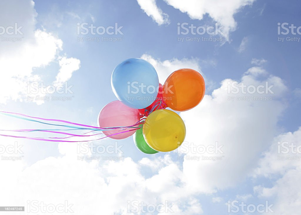 Released Balloons on Cloudy Day stock photo