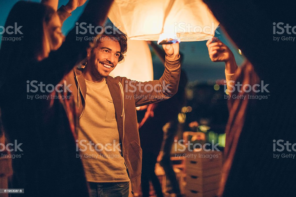 Releasing a Chinese lantern stock photo