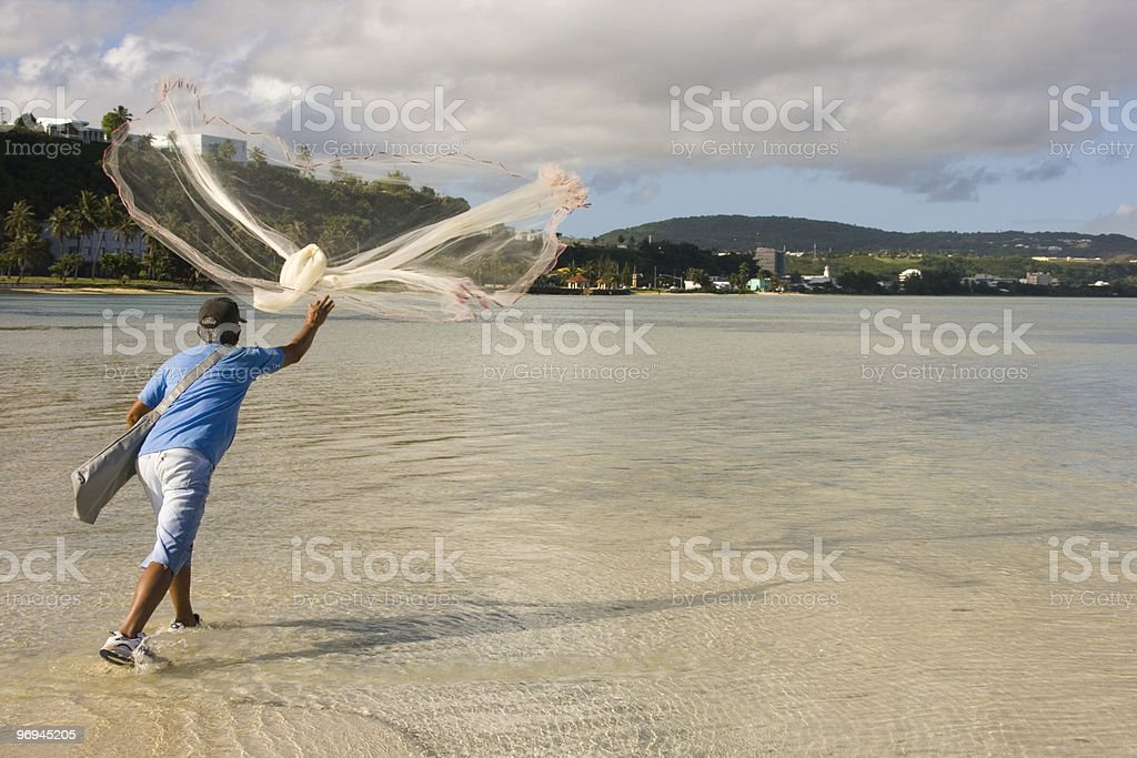 Releasing cast net royalty-free stock photo