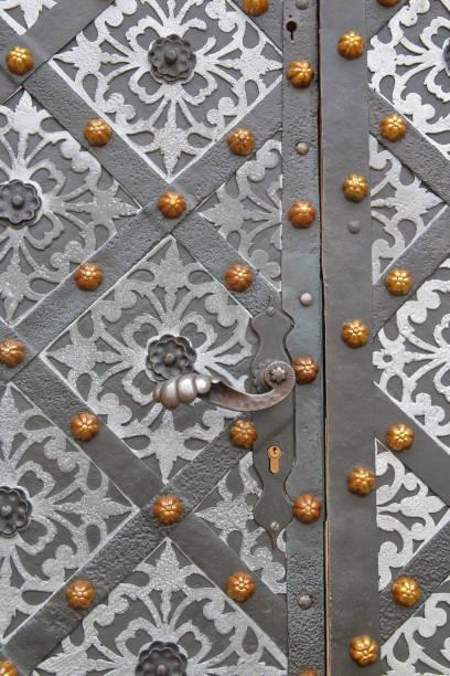 Reliable metal door of an old building in Krakow.
