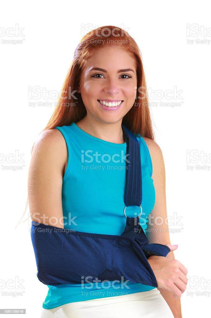 Relief and smiling young woman wearing shoulder brace stock photo