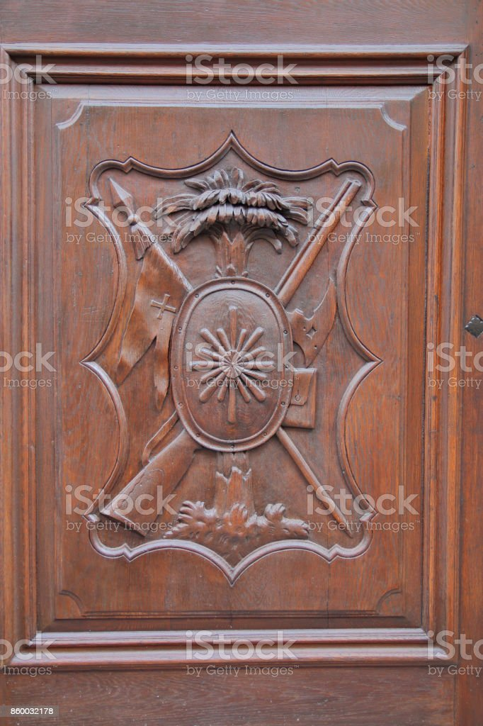 Relief carving on a wooden door. stock photo