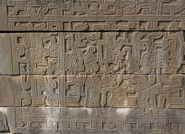 Relief Sculpture of a Ceremonial Sacrifice at El Tajin, Mexico Ceremonial Sacrifice on a Relief at El Tajin, Mexico el tajin stock pictures, royalty-free photos & images