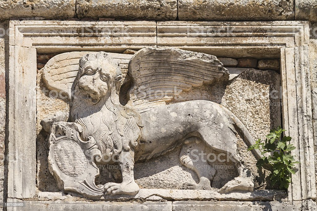 Relief sculpture of venetian winged lion royalty-free stock photo