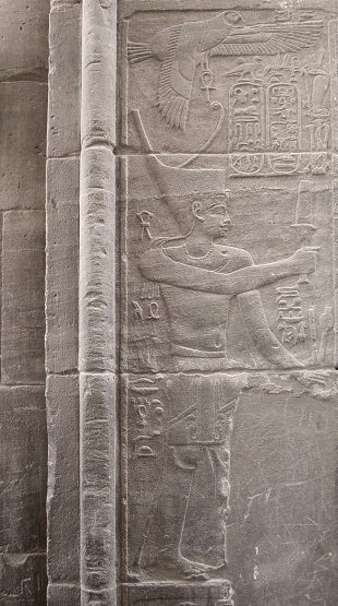 detail of a ancient stone relief showing a Pharaoh in Egypt
