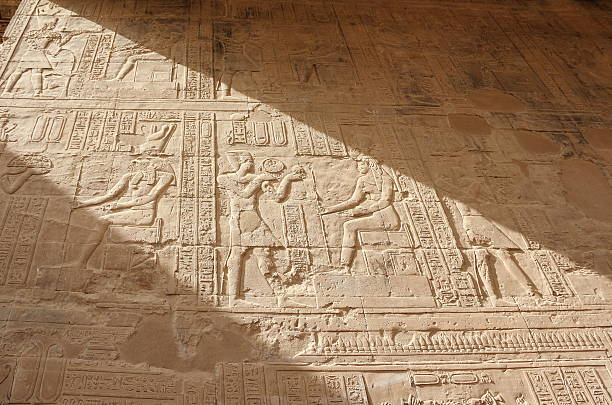 Reliefs on the walls of the Temple of Edfu. Egypt. stock photo