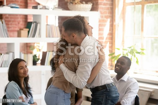 511741068 istock photo Relieved man and woman hugging giving psychological support during therapy 1139791198