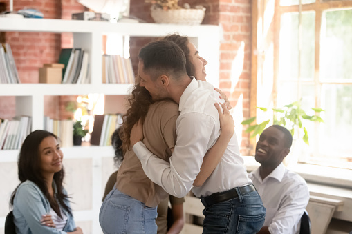 Relieved Man And Woman Hugging Giving Psychological
