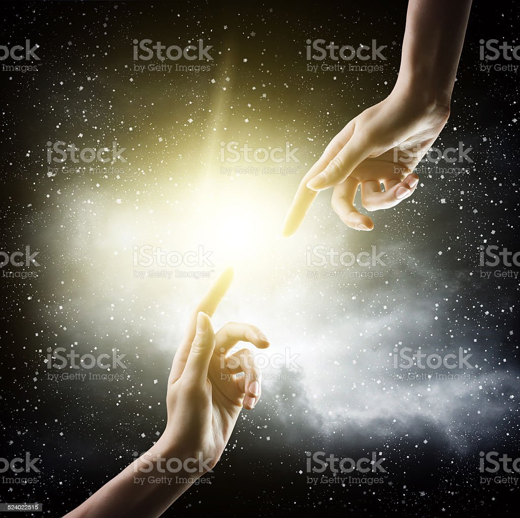 religion concept. finger touching the magic sky stock photo