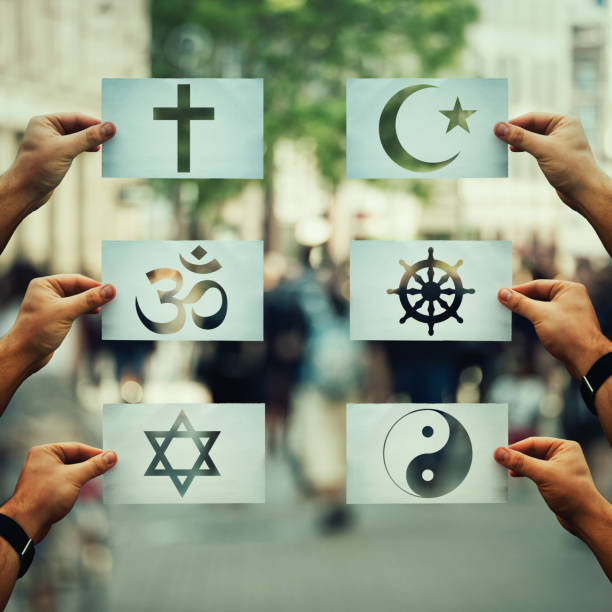 Religion conflicts global issue Religion conflicts as global issue concept. Human hands holding different paper with faith symbols over crowded street scene. Relations between different people doctrines and beliefs, social problem. religious symbol stock pictures, royalty-free photos & images