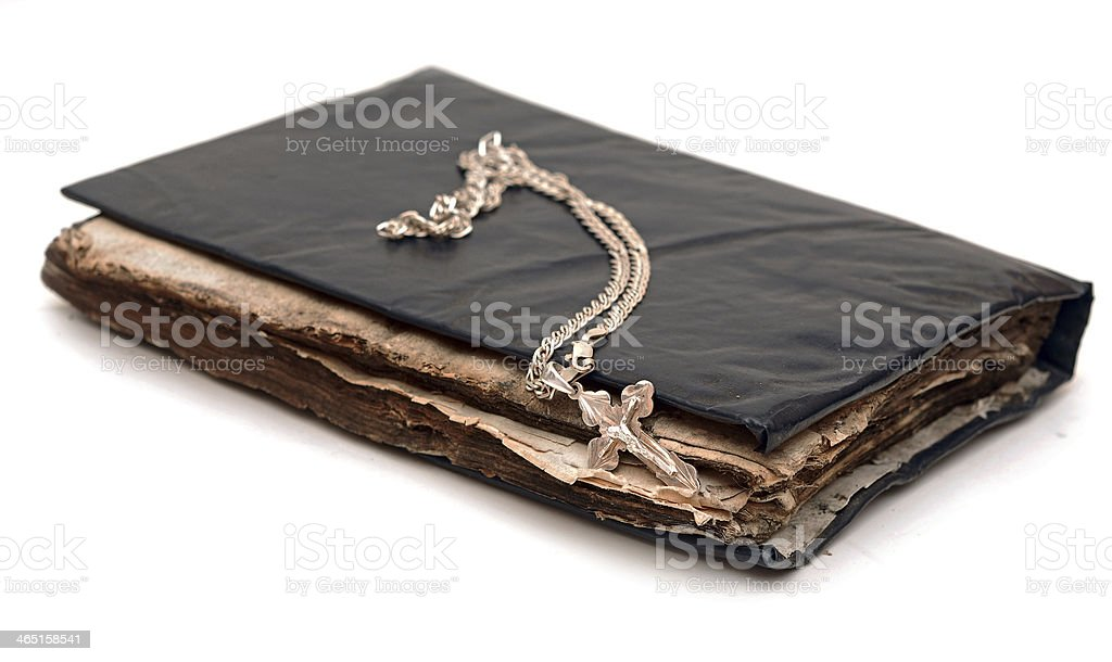 Religion. Cross with chain against a old book royalty-free stock photo