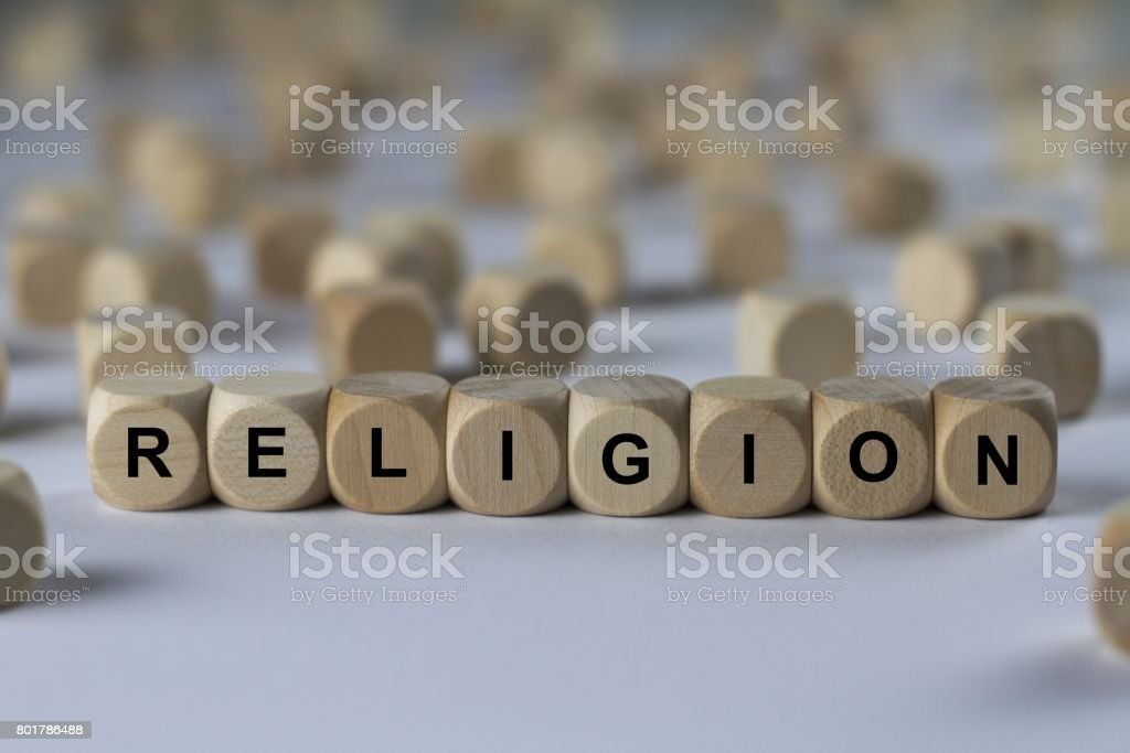 religion - cube with letters, sign with wooden cubes stock photo