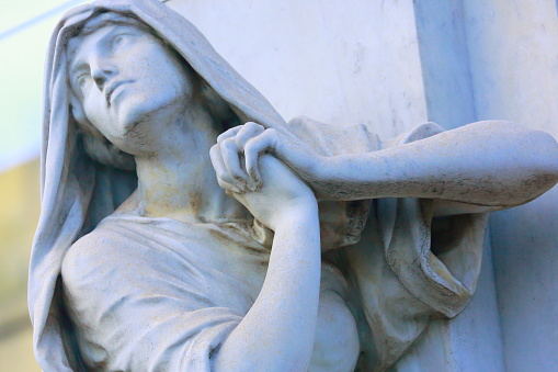 Religion hope: Pensive Madonna praying hands clasped, Recoleta cemetery