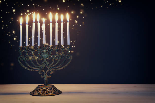 Religion image of jewish holiday Hanukkah background with menorah (traditional candelabra) and candles – zdjęcie