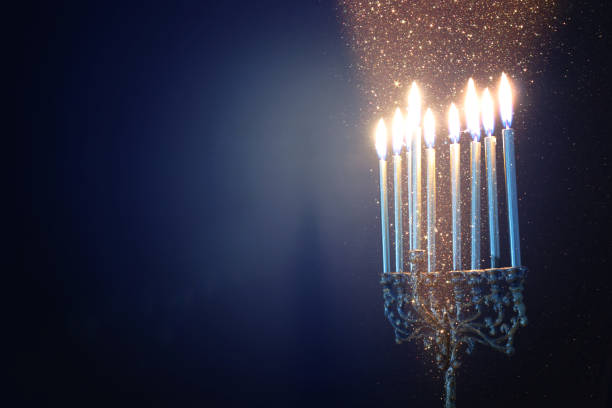 Religion image of jewish holiday Hanukkah background with menorah (traditional candelabra) and candles stock photo