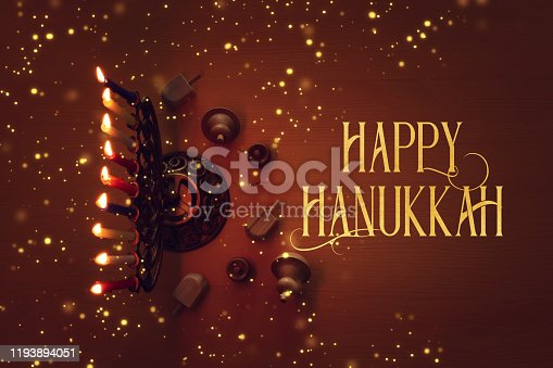 religion image of jewish holiday Hanukkah background with menorah (traditional candelabra), candles and spinning top