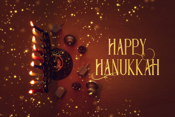 religion image of jewish holiday Hanukkah background with menorah (traditional candelabra), candles and spinning top religion image of jewish holiday Hanukkah background with menorah (traditional candelabra), candles and spinning top hanukkah stock pictures, royalty-free photos & images
