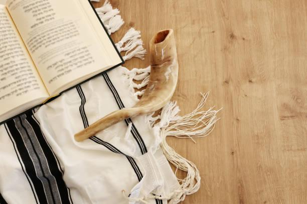 religion image of Prayer book and Shofar (horn) jewish religious symbols. Rosh hashanah (jewish New Year holiday), Shabbat and Yom kippur concept stock photo