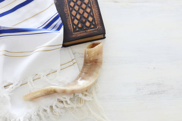 religion image of Prayer Shawl - Tallit, Prayer book and Shofar (horn) jewish religious symbols. Rosh hashanah (jewish New Year holiday), Shabbat and Yom kippur concept. – zdjęcie