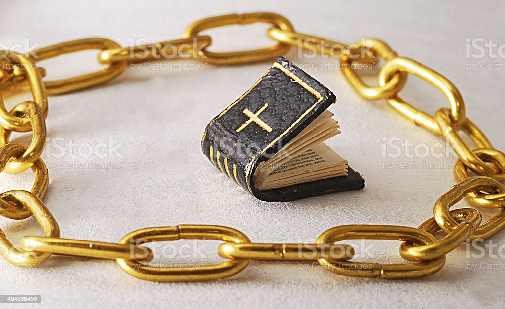 religion in chains - bible stock photo