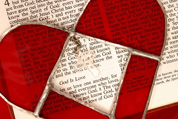 Religious: Bible Scripture God is Love with stained glass heart stock photo
