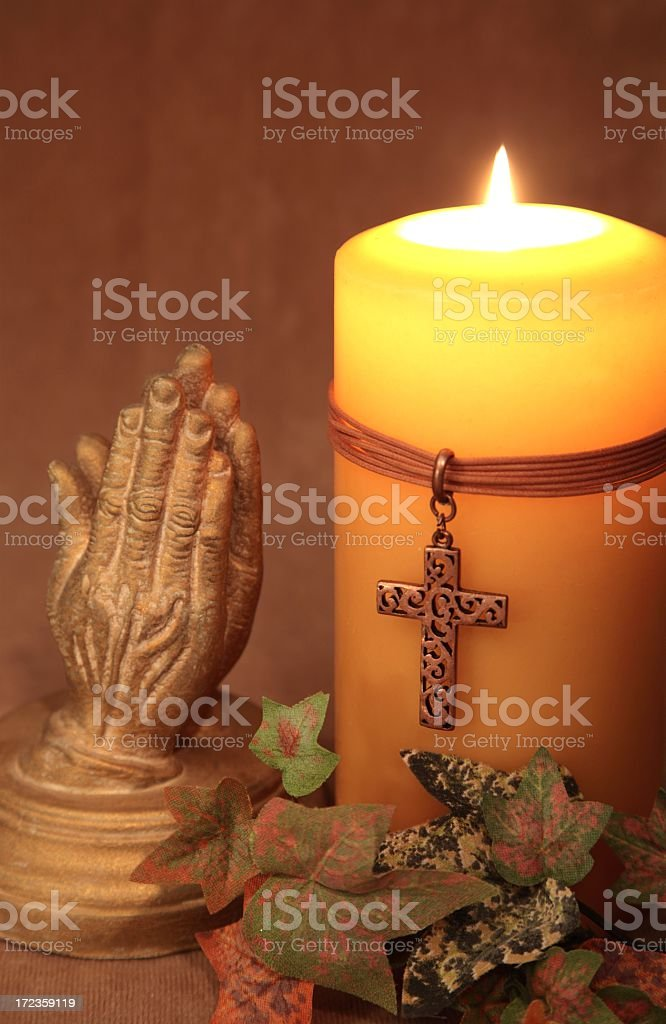 Religious: Candle with Cross and praying hands Series royalty-free stock photo