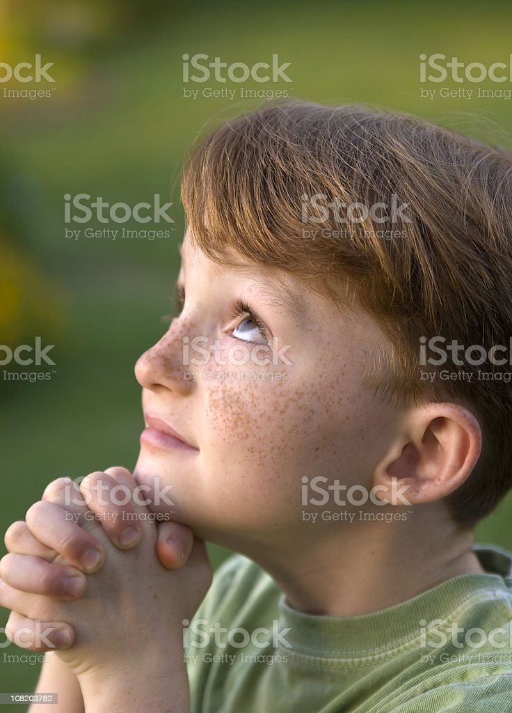 Religious Child, Boy Redhead with Freckles Praying, Side View Profile royalty-free stock photo