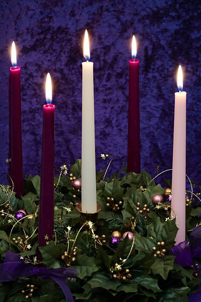 Religious: Christmas Advent Wreath with burning candles stock photo