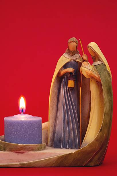 Religious: Christmas Nativity Candle holder on red background stock photo
