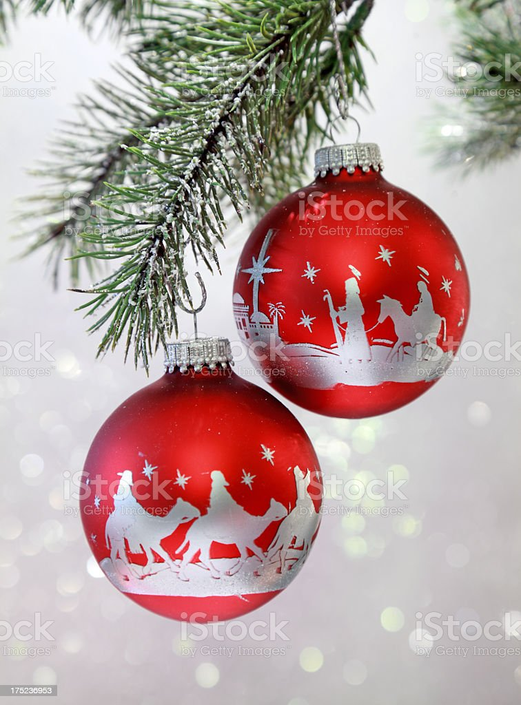 religious christmas nativity scene on red and silver ornaments royalty free stock photo