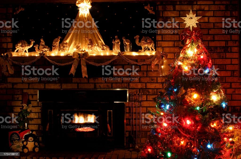 religious christmas scene of tree mantle fire place and nativity royalty free