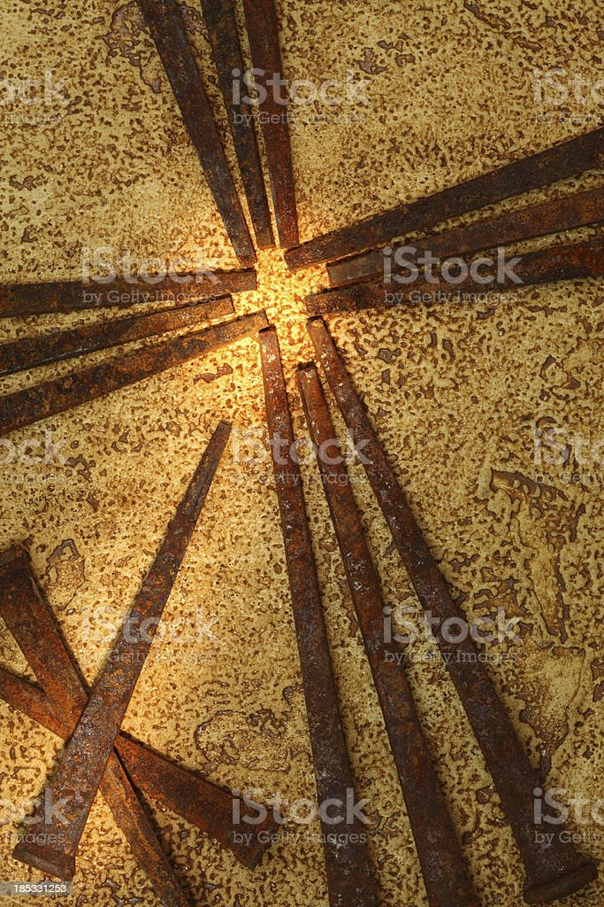 Religious: Cross of Old Square Rusty Nails royalty-free stock photo