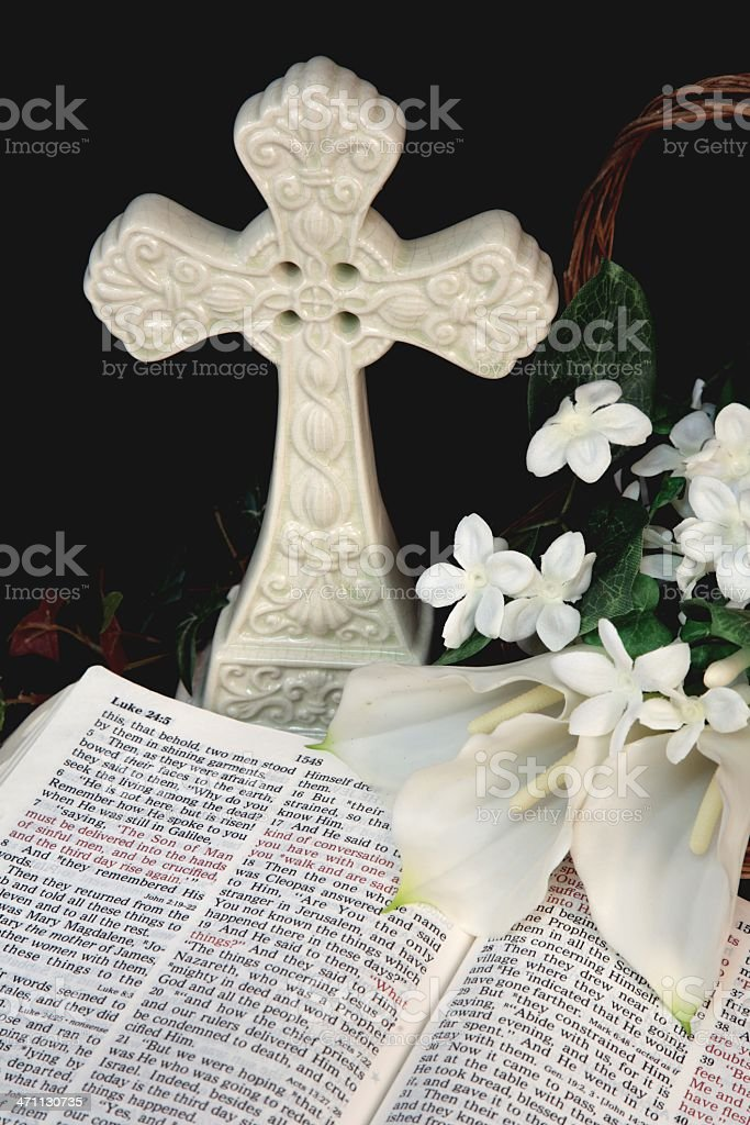Religious: Easter Bible Scripture with white cross and flowers stock photo