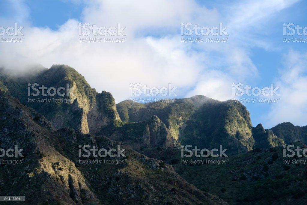 religious moment - sun in the mountains stock photo
